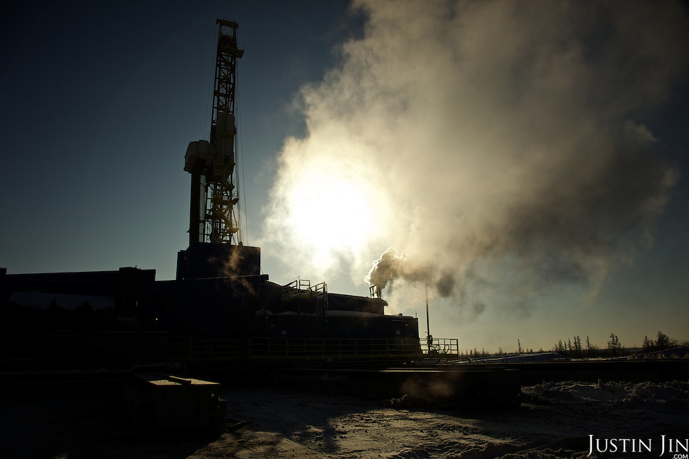 Siloutte of Achimgaz gas drilling well in Novy Urengoi, Siberia, Russia.