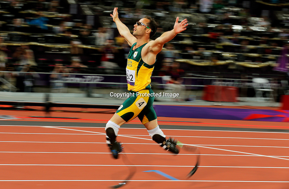 Oscar Pistorius of South Africa celebrates after winning gold in the men's 400m - T44 final at the Olympic Stadium during the London 2012 Paralympic Games, London, Britain, 08 September 2012.  EPA/KERIM OKTEN