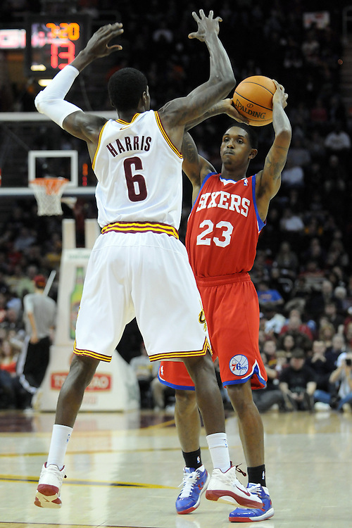 Feb. 27, 2011; Cleveland, OH, USA; Philadelphia 76ers point guard Lou Williams (23) trys to make a pass around Cleveland Cavaliers guard Manny Harris (6) during the second quarter at Quicken Loans Arena. Mandatory Credit: Jason Miller-US PRESSWIRE