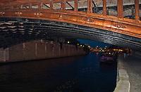 Paris, under a Seine bridge at night