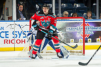 KELOWNA, CANADA - DECEMBER 7: Kyle Topping #24 of the Kelowna Rockets looks for the pass in front of the net against the Victoria Royals on December 7, 2018 at Prospera Place in Kelowna, British Columbia, Canada.  (Photo by Marissa Baecker/Shoot the Breeze)