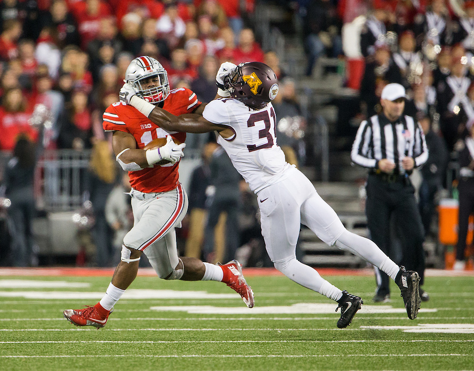Ohio State University running back Ezekiel Elliott (15) is tackled by University of Minnesota defensive back Eric Murray (31) ball during the second half of a NCAA Division I football game between Ohio State University and the University of Minnesota at Ohio Stadium on November 7, 2015 in Columbus, Ohio. (Dustin Satloff)