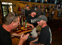 Edward Stettmeier of Milton, NH at the bar with Larry Sharpe and Richard Patterson from Woodstock New Brunswick Canada at the Whiskey Barrel in downtown Laconia Tuesday evening.  (Karen Bobotas/for the Laconia Daily Sun)