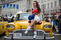 © licensed to London News Pictures. London, UK 12/05/2013. A cheerleaders posing on a classic American taxi as she represents the USA at The World on Regent Street event in London on Sunday, 12 May 2013. Many countries showcase the best of each country's culture, music and dance, art, food and fashion to Londoners on Regent Street. Photo credit: Tolga Akmen/LNP