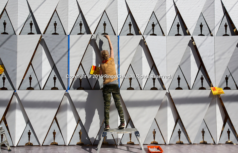 A worker paints the scenic walls in the red carpet arrivals area in front of the Dolby Theatre on Thursday Feb. 25, 2016 in Los Angeles. The 88th Academy Awards will be held Sunday, February 28, 2016. (Photo by Ringo Chiu/PHOTOFORMULA.com)<br /> <br /> Usage Notes: This content is intended for editorial use only. For other uses, additional clearances may be required.