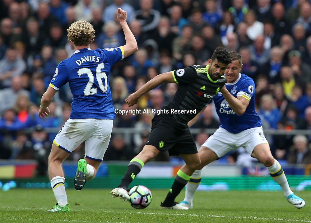 April 30th 2017, Goodison Park, Liverpool, England; EPL Premier league football, Everton versus Chelsea; Diego Costa of Chelsea controls the ball as he is closed down by Tom Davies and Phil Jagielka of Everton