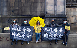 Edinburgh, Scotland, UK. 24 July, 2020. Protesters hold a Fridays for Freedom, Hong Kong pro-democracy protest outside St Giles Cathedral in Edinburgh Old Town today. Fridays for Freedom protests are held in cities around the world and are intended to highlight the attack on human rights and freedom by the Chinese Government on Hong Kong. Iain Masterton/Alamy Live News