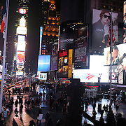 A view of Times Square Manhattan, showing an advert for the new Cold War drama series The Americans. Times Square, New York, USA. 16th January 2013. Photo Tim Clayton.Photo Tim Clayton Note to Editors. This image is a composite of three images taken a split second apart and merged in editing.