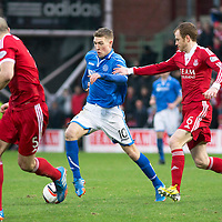 Aberdeen v St Johnstone....01.02.14   League Cup Semi-Final<br /> David Wotherspoon is closed down by Mark Reynolds<br /> Picture by Graeme Hart.<br /> Copyright Perthshire Picture Agency<br /> Tel: 01738 623350  Mobile: 07990 594431