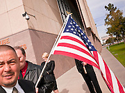 06 FEBRUARY 2012 - PHOENIX, AZ:    Arizona State Senator STEVE GALLARDO, (left) a Democrat, walks to a press conference to announce his opposition to a state bill that would allow concealed weapons on college campuses on Monday, Feb. 6. The Arizona State Senate's Judiciary Committee, chaired by Sen Ron Gould (Republican) debated several bills Monday that would loosen the state's gun laws, already among the loosest in the United States. One bill would allow anyone with a concealed carry permit to carry guns on the grounds of public universities. Universities could only ban guns if they provided secured gun lock boxes in each building. Universities, which are opposed to the legislation, say that the lock boxes would cost hundreds of thousands of dollars and that guns would make the campuses less safe. Most of the police departments in Arizona, as well as university student bodies, also oppose the legislation to allow guns on campus.  PHOTO BY JACK KURTZ