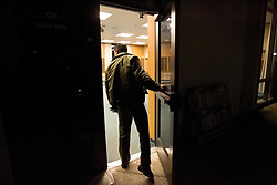 Stanford after dark. Mike Kim of Stanford Security checks out room 124 Meyer Forum room.