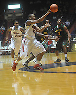 "Ole Miss guard Dundrecous Nelson (5)  passes at the C.M. ""Tad"" Smith Coliseum in Oxford, Miss. on Sunday, January 2, 2011. (AP Photo/Oxford Eagle, Bruce Newman)"