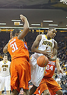 November 29, 2011: Iowa Hawkeyes forward Melsahn Basabe (1) tries to drive between Clemson Tigers forward/center Devin Booker (31) and Clemson Tigers forward Milton Jennings (24) during the first half of the NCAA basketball game between the Clemson Tigers and the Iowa Hawkeyes at Carver-Hawkeye Arena in Iowa City, Iowa on Tuesday, November 29, 2011. Clemson defeated Iowa 71-55 in the Big Ten-ACC Challenge game.