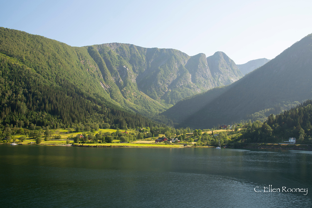 A scenic view of mountain peaks and farmland across Ese Fjord, Vestlandet, Norway