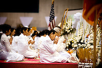 Family members pray during a Buddhist ceremony for General Vang Pao, in Fresno, Ca., on Sunday, Feb. 6, 2011. Vang Pao led Hmong guerrillas in a CIA-backed battle against communist forces in Laos and helped tens of thousands of Hmong resettle in American cities.