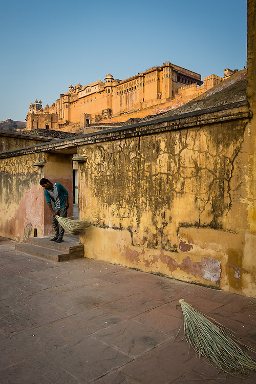 A man sweeps one of the entrances of Amber Palace, getting it ready for the day's tourists.