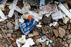 Piles of trash, including thousands of syringes and empty heroin bags, are found at the heroin camp located under the North Second Street overpass, in the Kensington Section of Philadelphia, PA, on July 31, 2017. A large joined operation of Conrail and the City of Philadelphia to clean up the popular open drug area is expected to take 30 days.