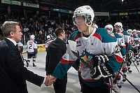 KELOWNA, CANADA - APRIL 25:  Ryan Olsen #27 of the Kelowna Rockets shakes hands with Mike Johnston, head coach of the Portland Winterhawks on April 25, 2014 during Game 5 of the third round of WHL Playoffs at Prospera Place in Kelowna, British Columbia, Canada. The Portland Winterhawks won 7 - 3 and took the Western Conference Championship for the fourth year in a row earning them a place in the WHL final.  (Photo by Marissa Baecker/Getty Images)  *** Local Caption *** Ryan Olsen; Mike Johnston;