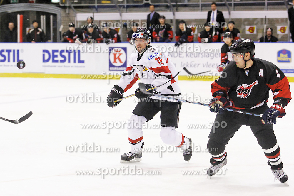 22.04.2010, Eishalle, IJssportcentrum, Tilburg, NED, IIHF Division I WM, Gruppe A, Österreich vs Japan im Bild Gregor Hager and Aaron Keller watch the airborn puck, EXPA Pictures © 2010, PhotoCredit: EXPA/ Fintan Planting