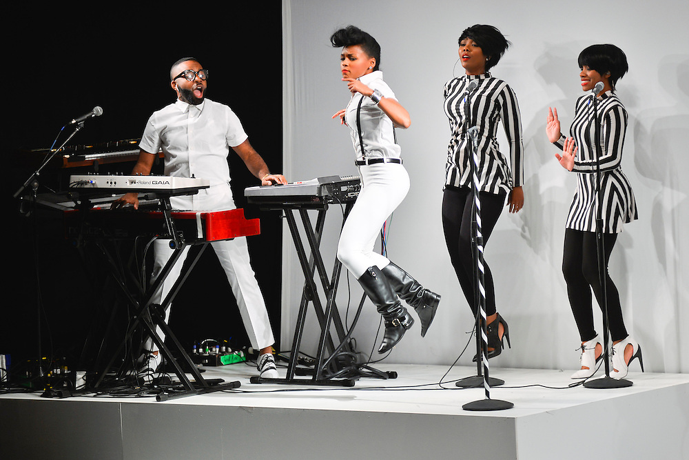 Janelle Monae performs onstage at the Rebecca Minkoff S/S 2014 fashion show at The Theatre, Lincoln Center on September 06, 2013 in New York City.