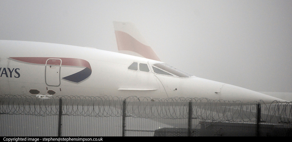 © Licensed to London News Pictures. 12/12/2012. Heathrow, UK A retired British Airways Concorde sits in the ice and fog on the tarmac. Planes in the fog at Heathrow airport this morning. Heavy fog is causing flights to be delayed and disruption across the country.  Photo credit : Stephen Simpson/LNP