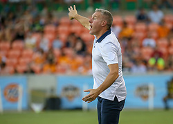 July 18, 2018 - Houston, TX, U.S. - HOUSTON, TX - JULY 18:  Sporting Kansas City head coach Peter Vermes yells out to his players during the US Open Cup Quarterfinal soccer match between Sporting KC and Houston Dynamo on July 18, 2018 at BBVA Compass Stadium in Houston, Texas. (Photo by Leslie Plaza Johnson/Icon Sportswire) (Credit Image: © Leslie Plaza Johnson/Icon SMI via ZUMA Press)