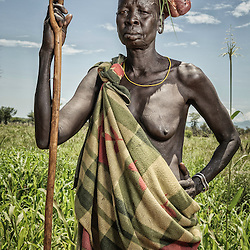 Woman carrying a cow leg on her head, Omo valley, Ethiopia