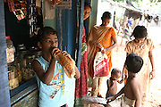 Budhia Singh, (left) 6, the famous Limca World Record marathoner, is having a soft drink by a shop near his home in Salia Sahi slum (pop. 30.000) of Bhubaneswar, the capital of Orissa State, on Sunday, May 18, 2008. On May 1, 2006, Budhia completed a record breaking 65 km run from Jagannath temple, Puri to Bhubaneswar. He was accompanied by his coach Biranchi Das and by the Central Reserve Police Force (CRPF). On 8th May 2006, a Government statement had ordered that he stopped running. The announcement came after doctors found the boy had high blood pressure and cardiological stress. As of 13th August 2007 Budhia's coach Biranchi Das was arrested by Indian police on suspicion of torture. Singh has accused his coach of beating him and withholding food. Das says Singh's family are making up charges as a result of a few petty rows. On April 13, Biranchi Das was shot dead in Bhubaneswar, in what is believed to be an event unconnected with Budhia, although the police is investigating the case and has made an arrest, a local goon named Raja Archary, which is now in police custody. **Italy and China Out**