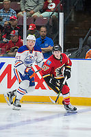 PENTICTON, CANADA - SEPTEMBER 17: Braden Christoffer #61 of Edmonton Oilers back checks Matthew Phillips #47 of Calgary Flames on September 17, 2016 at the South Okanagan Event Centre in Penticton, British Columbia, Canada.  (Photo by Marissa Baecker/Shoot the Breeze)  *** Local Caption *** Braden Christoffer; Matthew Phillips;
