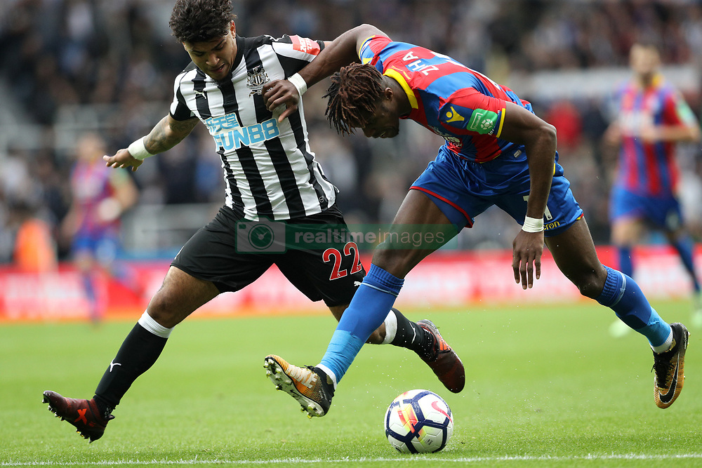 Newcastle United's DeAndre Yedlin (left) and Crystal Palace's Wilfried Zaha battle for the ball during the Premier League match at St James' Park, Newcastle.