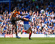 Christian Burgess gets to the ball ahead of John Akinde during the Sky Bet League 2 match between Portsmouth and Barnet at Fratton Park, Portsmouth, England on 12 September 2015. Photo by David Charbit.