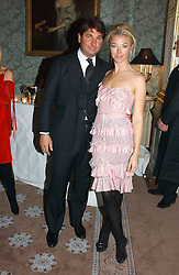 TAMARA BECKWITH and GEORGE VERONI at a dinner hosted by Krug champagne at Claridge's, Brooke Street, London on 14th February 2006.<br />