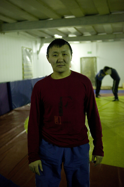 The Pole of Cold. Yakutian wrestling (Khapsagai) trainer at the sport complex in the village of Tomtor. The area is extremely cold during the winter. Two towns by the highway, Tomtor and Oymyakon, both claim the coldest inhabited place on earth (often referred to as -71.2°C, but might be -67.7°C) outside of Antarctica. The average temperature in Oymyakon in January is -42°C (daily maximum) and -50°C (daily minimum). The images had been made during an outside temperature in between -50°C up to -55°C. Tomtor, Jakutien, Yakutia, Russian Federation, Russia, RUS, 19.01.2010