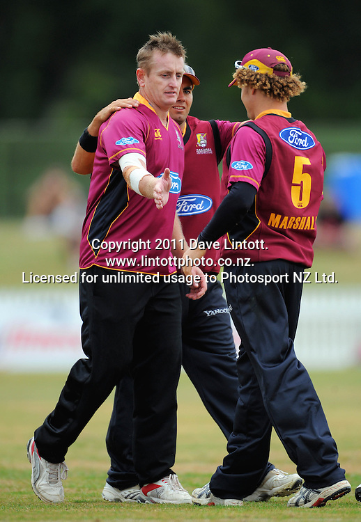 Knights' Jason Donnelly congratulates bowler Scott Styris (left) after captain James Marshall (right) caught Stags centurion George Worker for 109. One-day cricket - Central Stags v Northern Knights at Fitzherbert Park, Palmerston North, New Zealand on Wednesday, 12 January 2011. Photo: Dave Lintott / photosport.co.nz