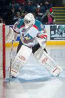 KELOWNA, CANADA - MARCH 5: Jordon Cooke #30 of the Kelowna Rockets marks up the ice in the crease against the Spokane Chiefs on March 5, 2014 at Prospera Place in Kelowna, British Columbia, Canada.   (Photo by Marissa Baecker/Getty Images)  *** Local Caption *** Jordon Cooke;