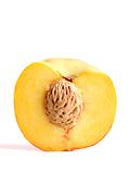 Halved peach on white background
