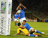 Marseille, FRANCE - 12th September 2007, Andrea Masi of Italy makes a crucial tackle during the Rugby World Cup, pool C, match between Italy and Romania held at the Stade Velodrome in Marseille, France...Photo: Ron Gaunt/ Sportzpics