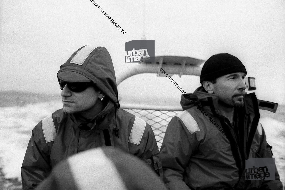 Bono and The Edge photographed on the Rainbow Warrior at a U2 Greenpeace protest at the Sellafield Nuclear Plant in June 1992.