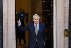 London, UK. 13 December, 2019. Prime Minister Boris Johnson returns to 10 Downing Street after making an address to the nation following the Conservative party's general election victory with a majority of 80 in the House of Commons.