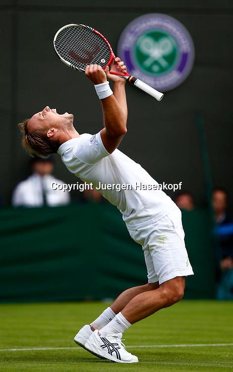 Wimbledon Championships 2013, AELTC,London,<br /> ITF Grand Slam Tennis Tournament, Steve Darcis (BEL) macht die Faust und jubelt nach seinem Sieg,Jubel,Emotion,Einzelbild,<br /> Ganzkoerper,Hochformat,Wimbledon Logo im Hintergrund,
