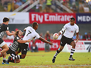 Fiji captain Osea Kolinisau offloads to Samisoni Viriviri during the Emirates Dubai rugby sevens match between Fiji  and England  at the Sevens Stadium, Al Ain Road, United Arab Emirates on 3 December 2016. Photo by Ian  Muir.*** during the Emirates Dubai rugby sevens match between *** and *** at the Sevens Stadium, Al Ain Road, United Arab Emirates on 3 December 2016. Photo by Ian  Muir.