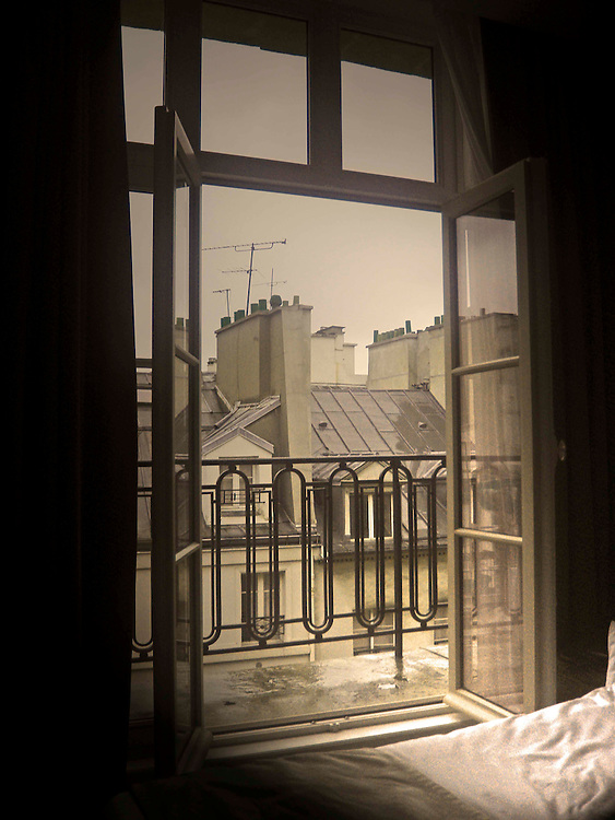 K + K Hotel Cayre, open window Paris rooftops iron railing balcony graphic design bed from small hotel