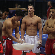 Steven Legendre, Norman, Oklahoma, (centre) and team mate Jake Dalton, (centre, right), with other athletes during warm up before the Senior Men Competition at The 2013 P&G Gymnastics Championships, USA Gymnastics' National Championships at the XL, Centre, Hartford, Connecticut, USA. 16th August 2013. Photo Tim Clayton