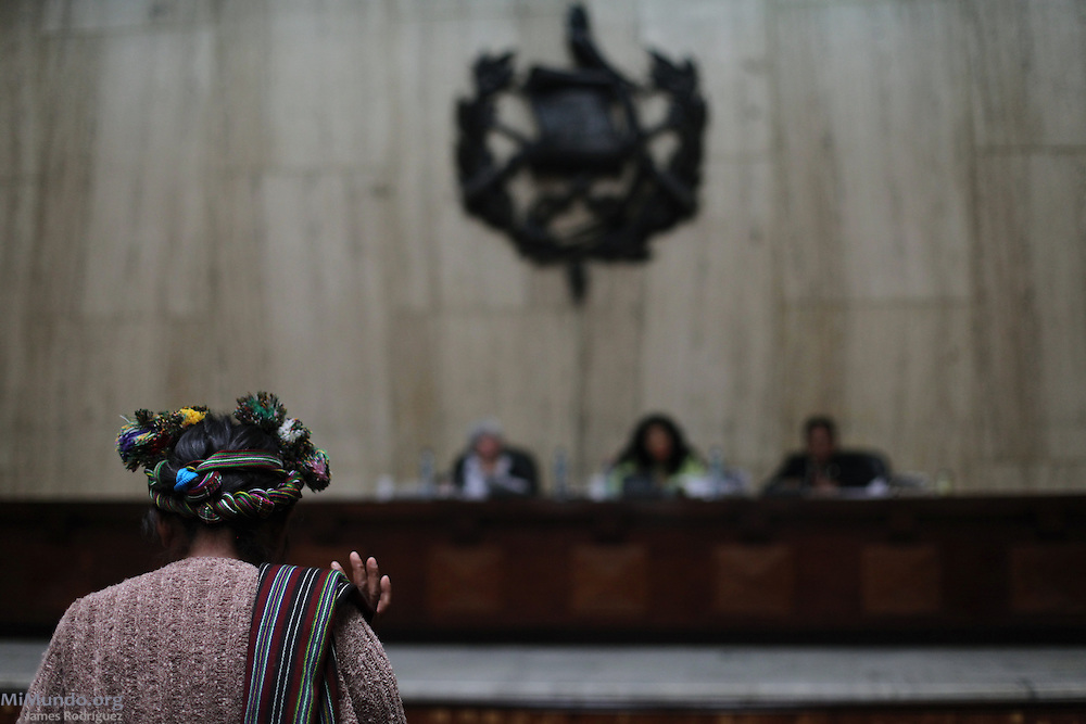 "Witness Magdalena Marcos De Leon, Ixil Mayan woman from Nebaj, raises her right hand before beginning her sworn testimony during the sixth day of the historic genocide trial against former de facto dictator Efrain Rios Montt and his head of Intelligence Jose Mauricio Rodriguez Sanchez. Both are accused of genocide and crimes against humanity committed against the Ixil Mayan people during their de facto reign from March 1982 to August 1983. Ms. Marcos De Leon states: ""After the army attacked our village, I saw how they captured my husband and decapitated him. I ran to the mountain with my five children and we remained there for a long time."" Guatemala, Guatemala. March 26, 2013."