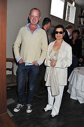 BIANCA JAGGER and JOHNNIE SHAND KYDD at a dinner hosted by Bella Freud for German artist Marcel Odenbach at her home 275 Kensal Road, London W10 on 6th June 2011.