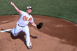 March 29, 2018 - Baltimore, MD, U.S. - BALTIMORE, MD - MARCH 29: Baltimore Orioles starting pitcher Dylan Bundy (37) pitches in the first inning during the Opening Day game between the Minnesota Twins and the Baltimore Orioles on March 29, 2018, at Orioles Park at Camden Yards in Baltimore, MD.  (Photo by Mark Goldman/Icon Sportswire) (Credit Image: © Mark Goldman/Icon SMI via ZUMA Press)