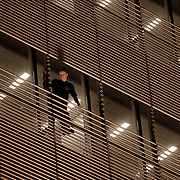 A man climbs the New York Times building during the early hours on July 9, 2008.