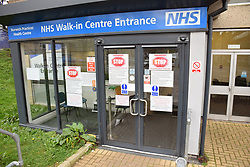 Coronavirus warning signs on NHS walk-in centre entrance, Norwich UK March 2020