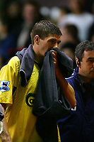 MANCHESTER, ENGLAND - MONDAY SEPTEMBER 20th 2004: Liverpool's Steven Gerrard walks off injured against Manchester United during the Premiership match at Old Trafford. (Photo by David Rawcliffe/Propaganda)