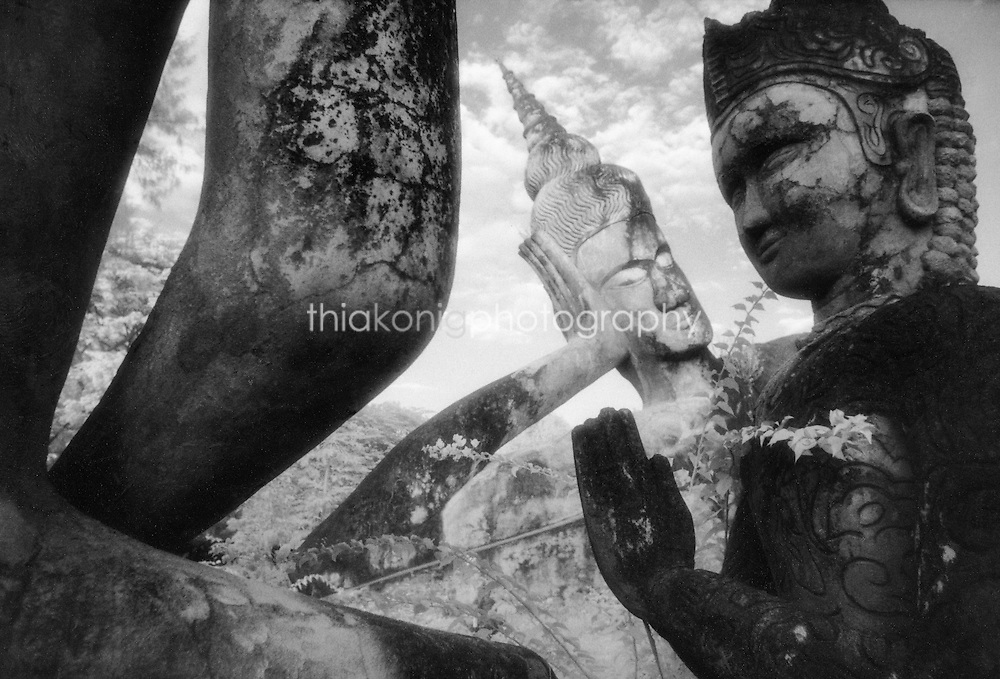 Black and white infrared image of stone buddhas, Buddha Park, Vientiane, Laos